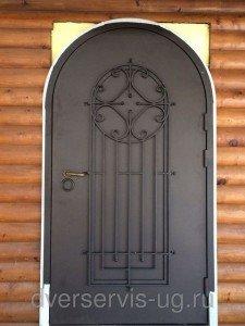 Арочные стальные двери с ковкой